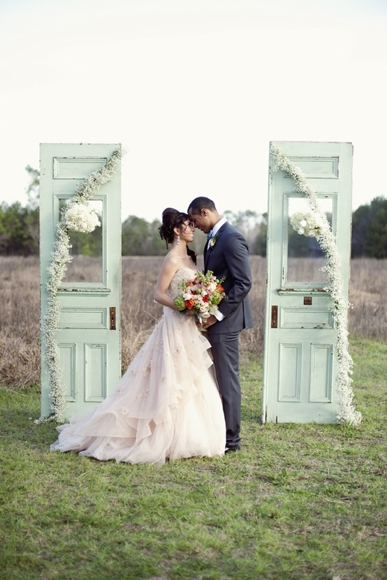 These Mint Green ceremony doors create quite the backdrop in this photo! We love it!