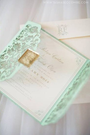 This breathtaking laser cut Mint Green Wedding Invitation takes our breath away!