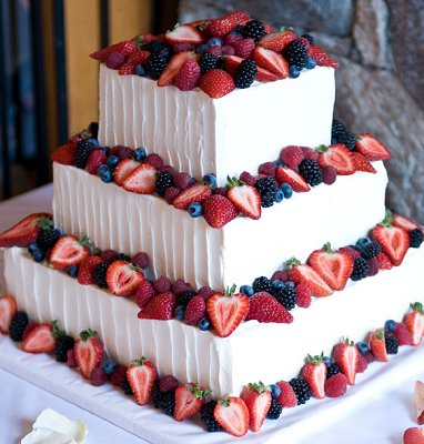 This Wedding Cake looks pretty perfect with all the delicious berries on it! What a great (and natural) way to incorporate Patriotic colors in your wedding!