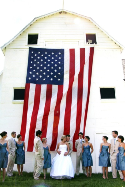 Such a great impromptu picture of the bride, groom and bridal party with the perfect flag backdrop.  Happy Birthday America!