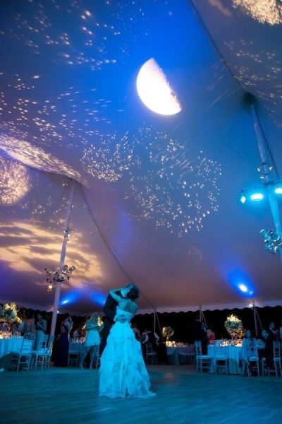 Your first dance under the moon and stars? Sure! Re-created on the tent for a picture perfect backdrop!  Photo Credit:   Karen Hill Photography