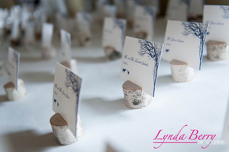 Birch Bark Escort Cards - Last but not least are these cute escort cards each placed in a tiny birch bark stump. Beautiful!