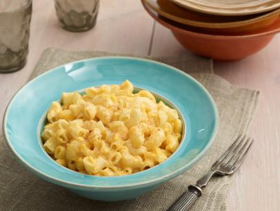 "Trisha Yearwood's Slow Cooker Macaroni and Cheese Recipe  - Last but not least is one of our favorite side dishes - Macaroni and Cheese. OH yum oh yum! But if you don't want to bring out a box of the bright powdered orange kind, we urge you to try this amazing recipe. Not only is it easy to assemble but you can make it right in your slow cooker. Be warned that this is a RICH Macaroni and Cheese. I've served it at Baby Showers (with sides of peas, lobster, bacon, etc) and I've made it for gangs of kids. It is always devoured and declared ""the best macaroni and cheese!"". We think so too!"
