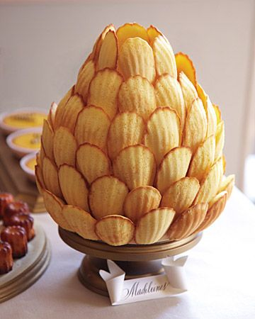 Madeleine Cookie Tree - Madeleines are delicious cookies and great for a party. We love this cookie tree because it looks like a pine cone! You could make chocolate madeleines and make it look even more like a pine cone! YUM!