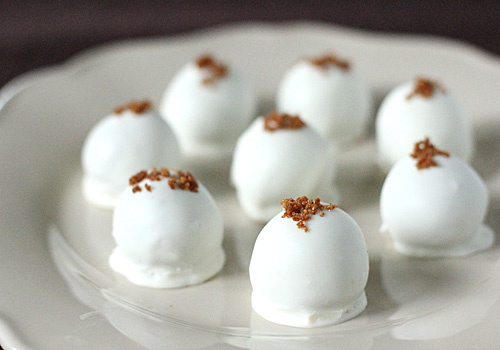 Pumpkin Cream Cheese Truffles - Candy is always dandy and these sweet little pumpkin truffles are just the ticket! These can be made ahead of time and are great to leave out for guests to nibble on before or after they take a post-mealnap.