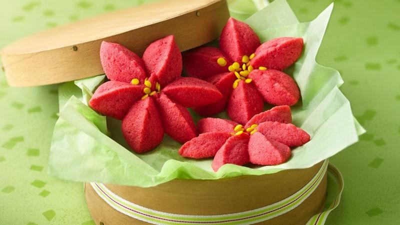 Raspberry Poinsettia Blossoms - This cookie gets raves for taste and for their color but it does seem like it's a hard cookie to make it look exactly like the photo. I think this cookie would be great as a SPRITZ cookie and think that you could make quite a few of these this way. We LOVE the idea of changing up the raspberry flavor with cranberry, strawberry or cherry!