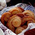 Palmiers / Photo Credit: Mark Thomas - There are many recipes for Palmiers online that use frozen puff pastry dough and they will all look nice and taste OK but to me, missing the butter in the Palmier is like Christmas without Santa! You've gotta have the butter!! This recipe is not the traditional way to make a Palmier but it will produce a buttery and delicious cookie that will look impressive. You can also make the dough ahead of time and freeze them and then just slice and bake when you want to have them.