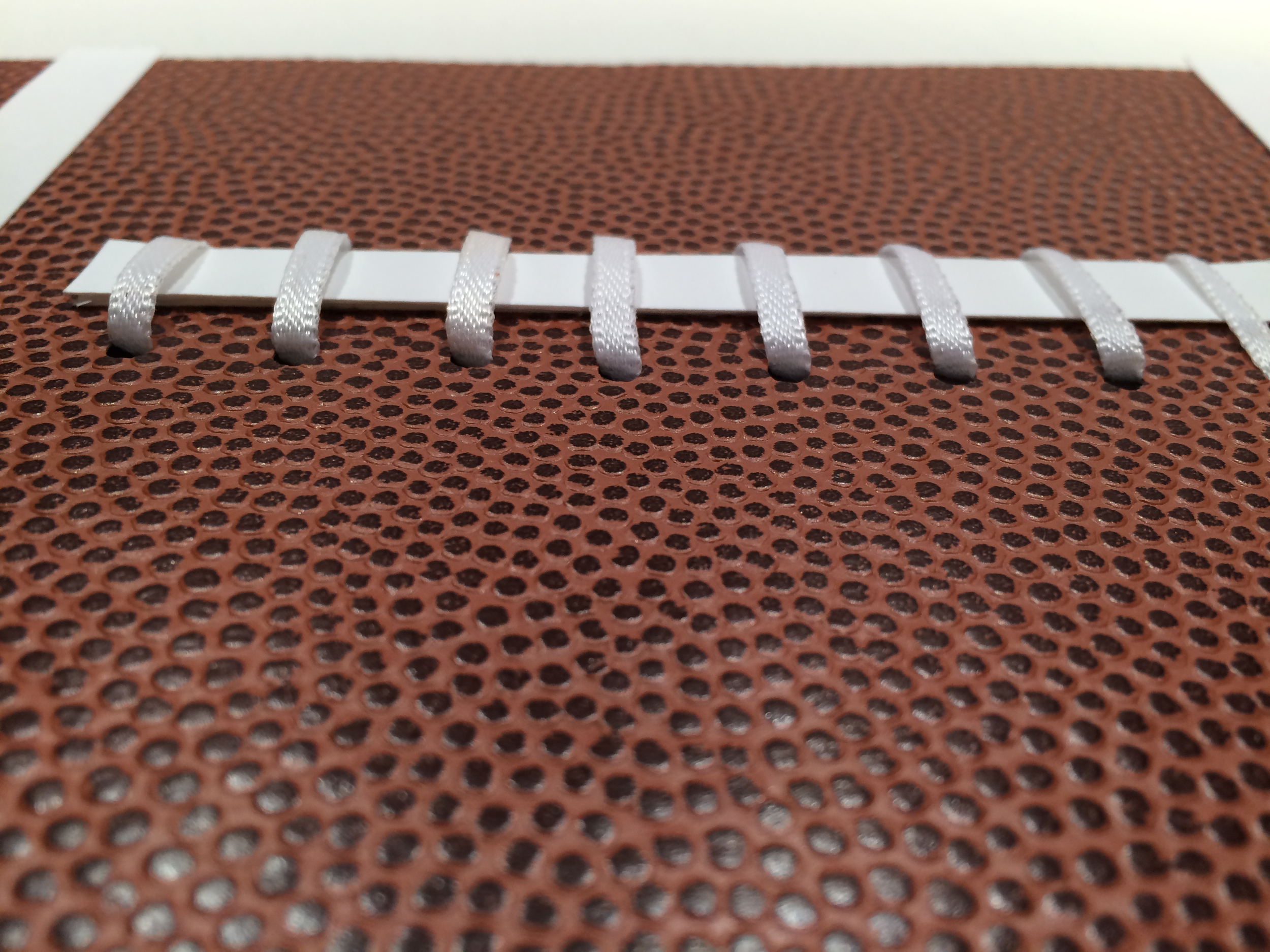 This is a close-up of the laces and the Football paper. Isn't it so cool?