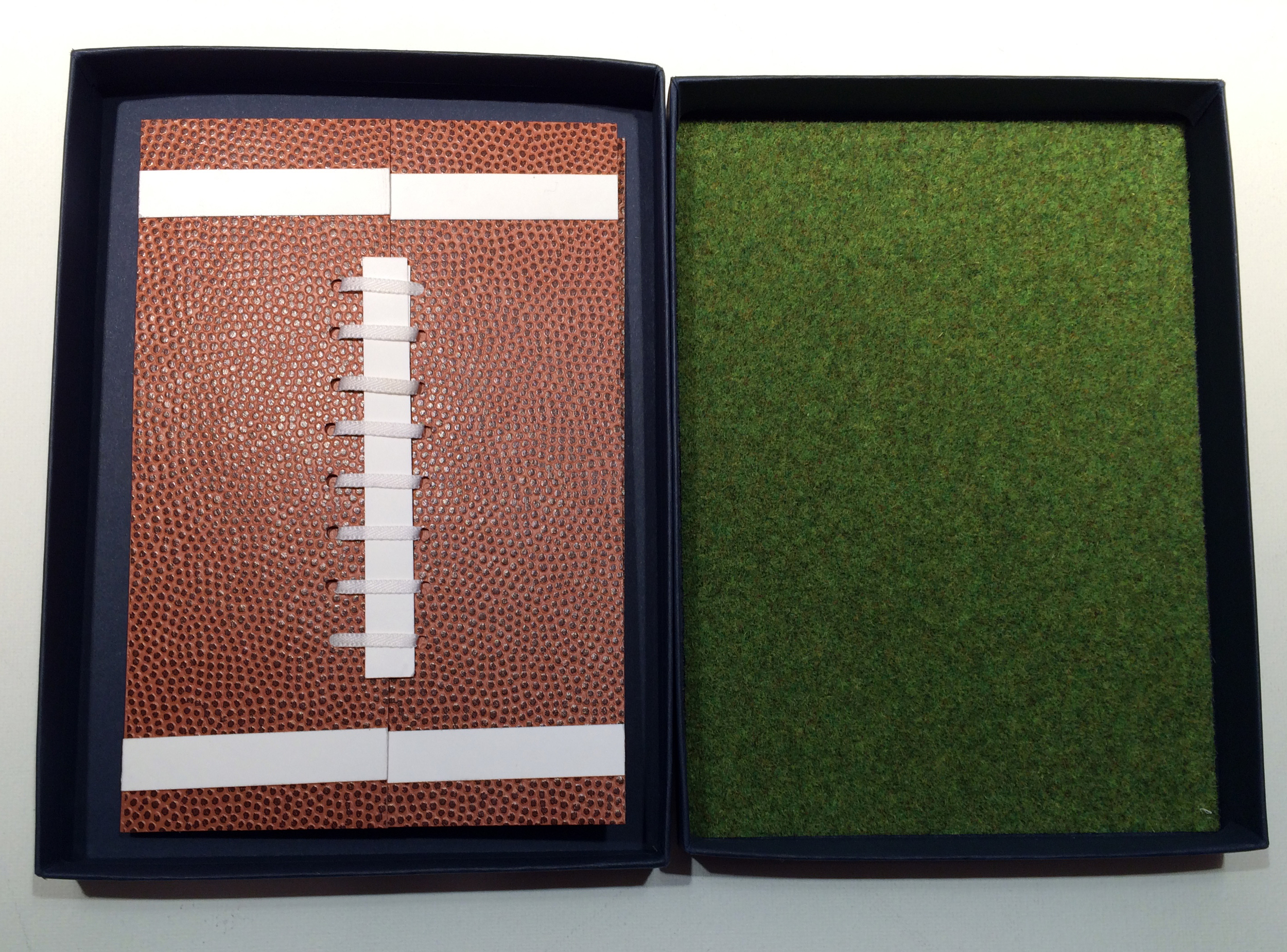 """Here's the finished football invitation folder in the box lined with the """"Astroturf"""" paper."""