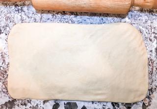 rolling cereal milk bun dough into a rectangle.jpg