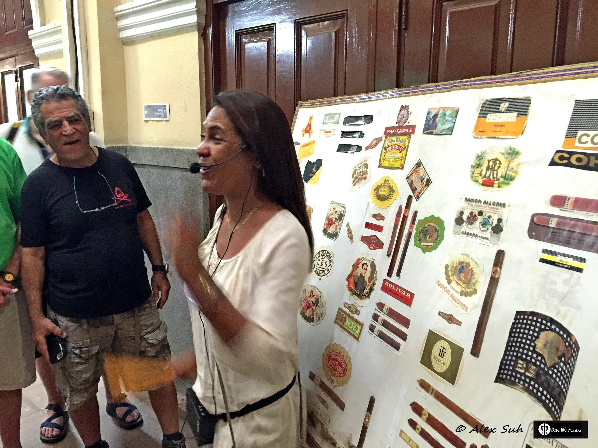 Cigar factory tour guide showing the different brands of Cuban cigars