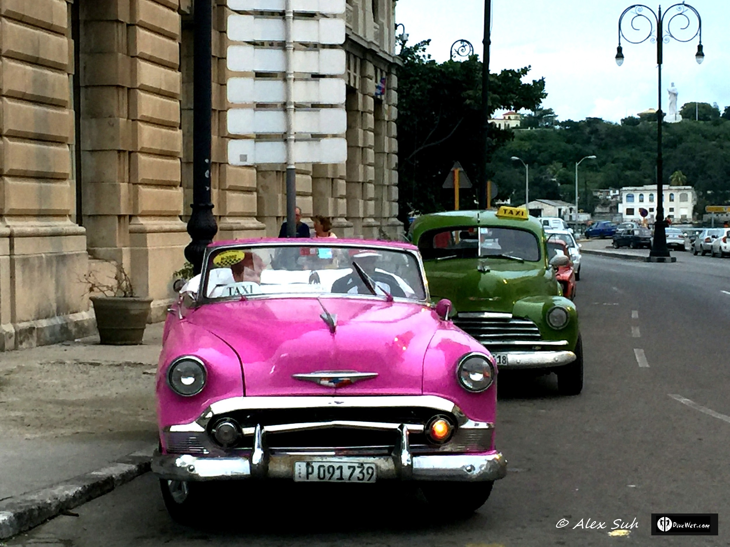 Two old classic cars. Most all old classic cars are owned by the government and lent to the hardest workers in Cuba, but not for personal use.