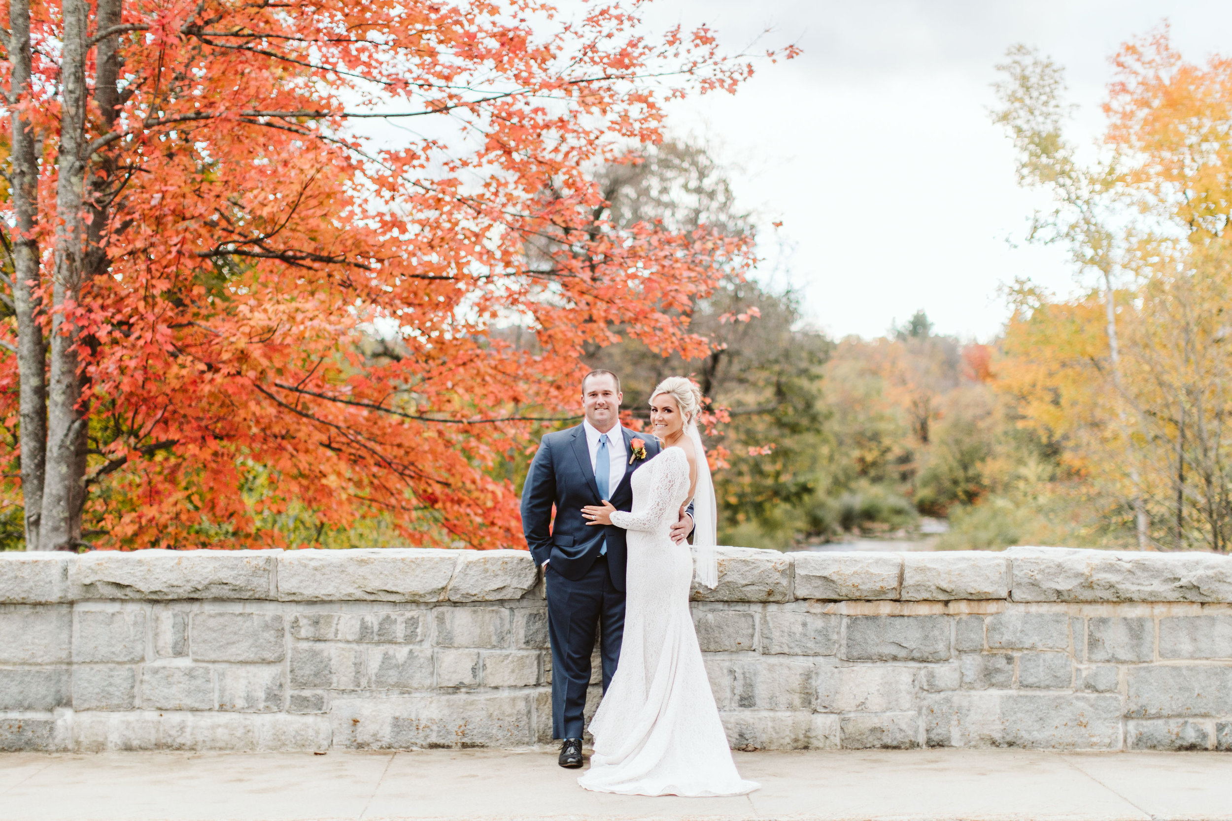 Shannon + Mitch taking advantage of the foliage during their autumn wedding at The Wentworth (Jackson, NH)