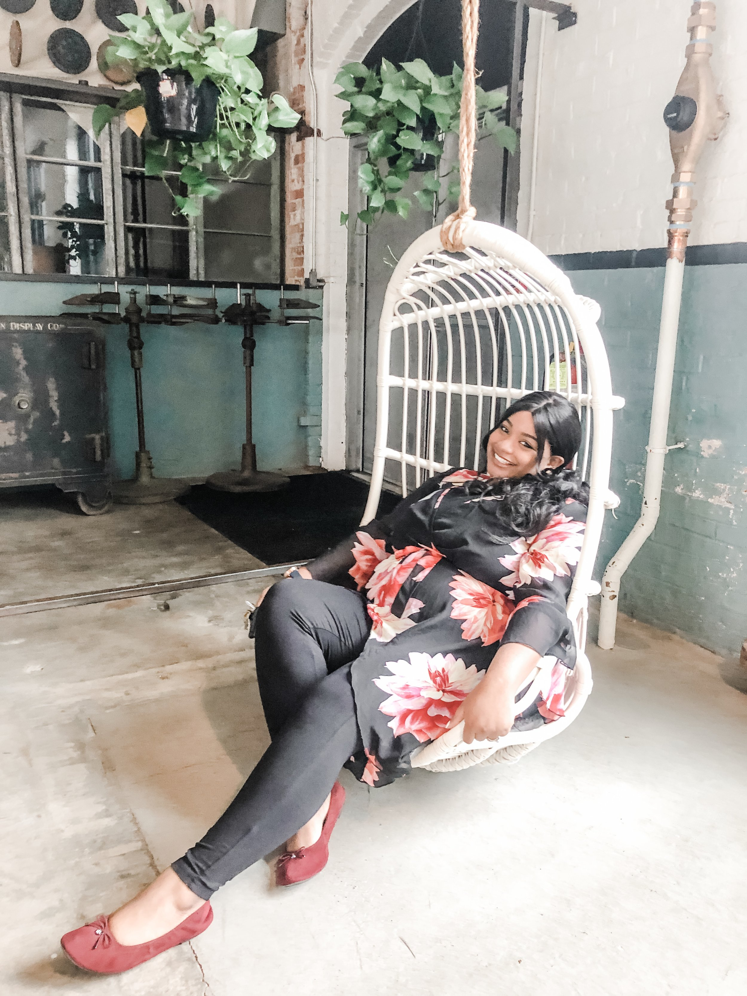 Our girl Lashana Burley, of  Jamal & Lashana Photography , loving the hanging chairs at Rooms & Works!