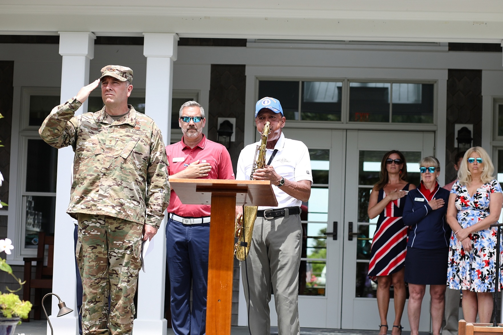 "Major General Gary Keefe, the Adjunct General, Massachusetts National Guard at attention during the presentation of colors after delivering the opening remarks. Michael ""Tunes"" Atunes of John Cafferty and the Beaver Brown Band played the Star Spangled Banner on his saxophone."