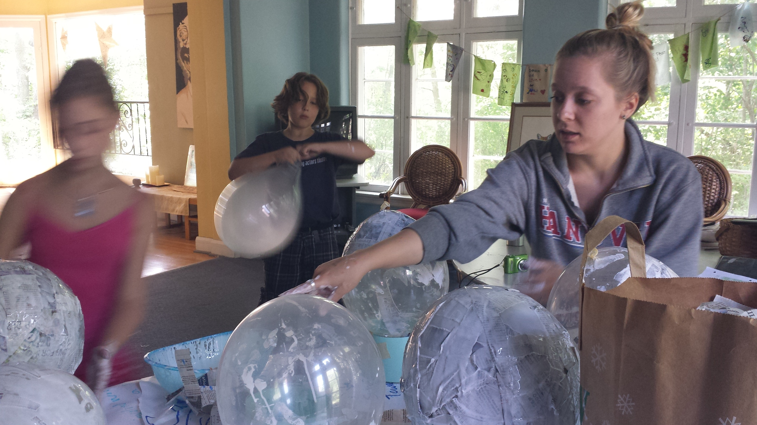 Author Alexis Litz, left, works with campers on a project that involved visualizing CO2: one pound of CO2 = the equivalent of 28 balloons.