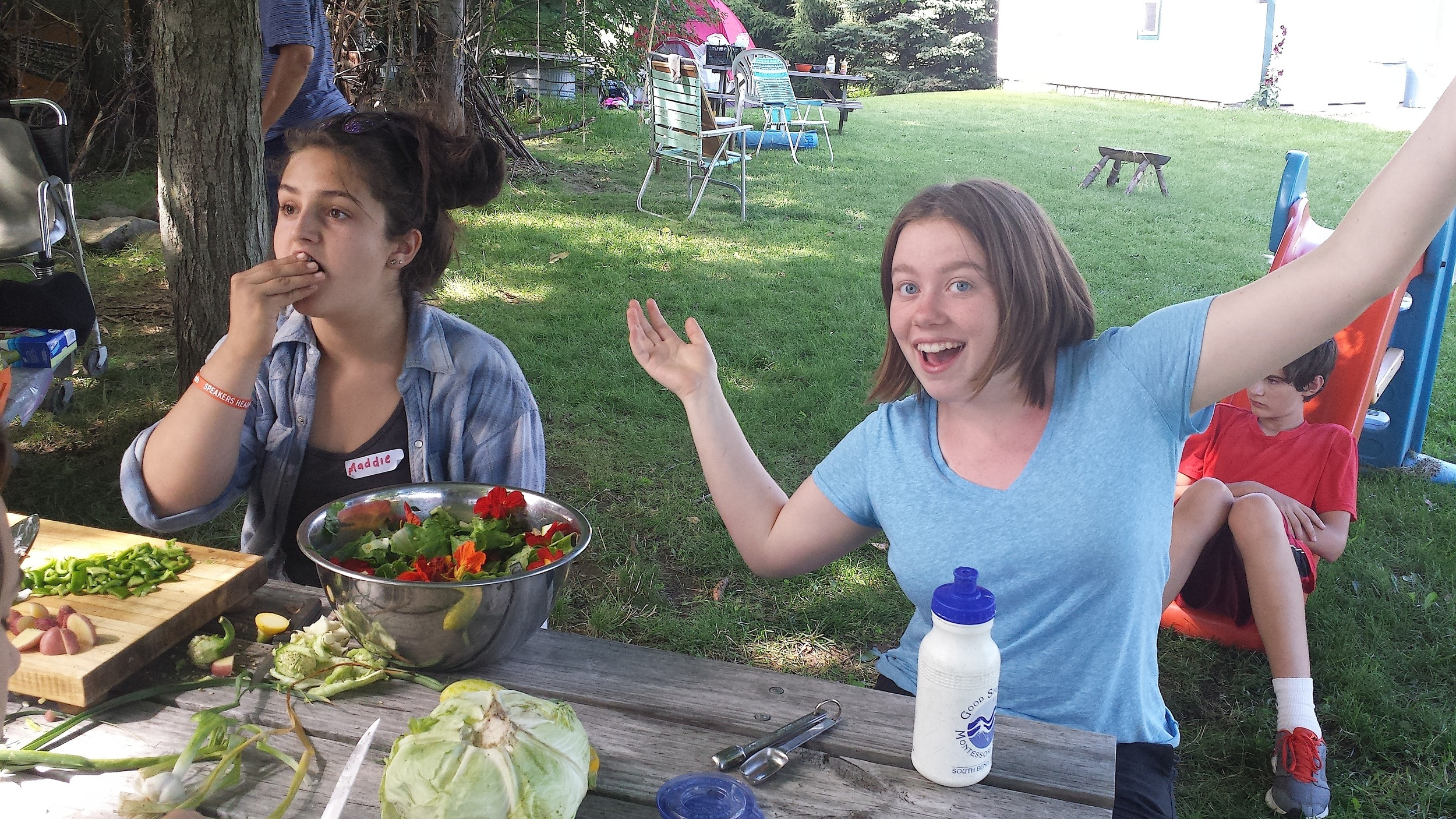 Maddie, left, from Indianapolis, and the author, Julia, on the right, prepare locally sourced food for dinner.