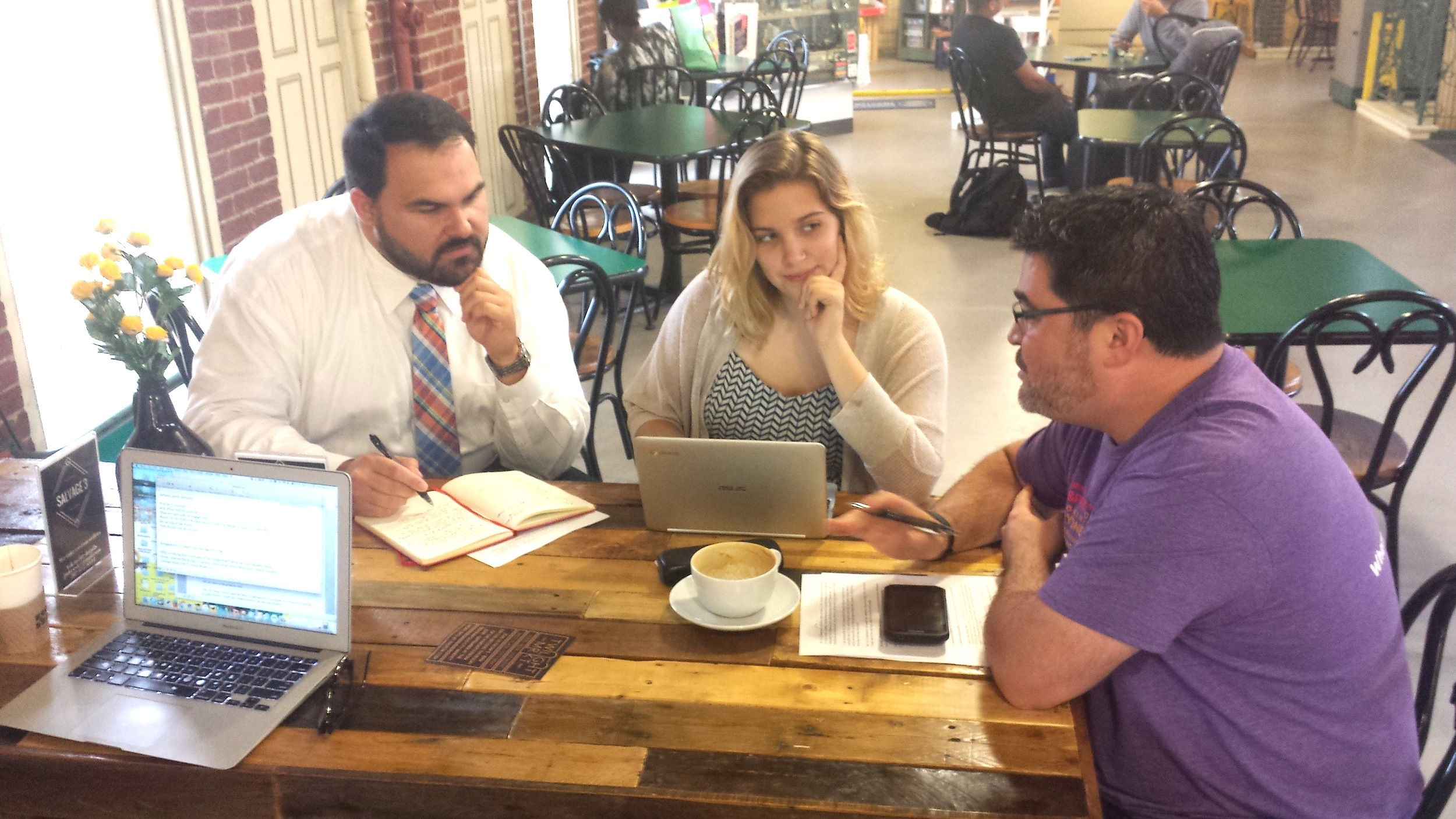 On Aug. 15, City Councilors Jared Evans (left) and Zach Adamson (right) met with North Central High School Sophomore Cora Gordon to discuss the Climate Recovery Resolution and its next steps.