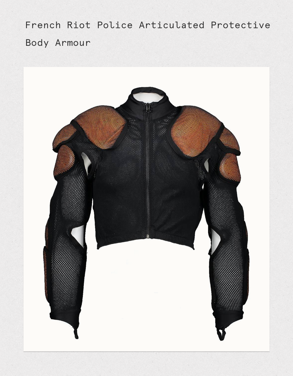 Zip up Airtex mesh top with Lycra neck opening, closure with front zipper. Over the thumb fitting on the sleeves to stop them from riding up. Hard foam padding to up shoulder and lower back arm. Three shaped pads on shoulder, three smaller pads on the elbow and lower arm. Size: Small.