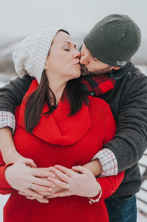 winter-engagement-couple-kissing-killington-vermont.jpg
