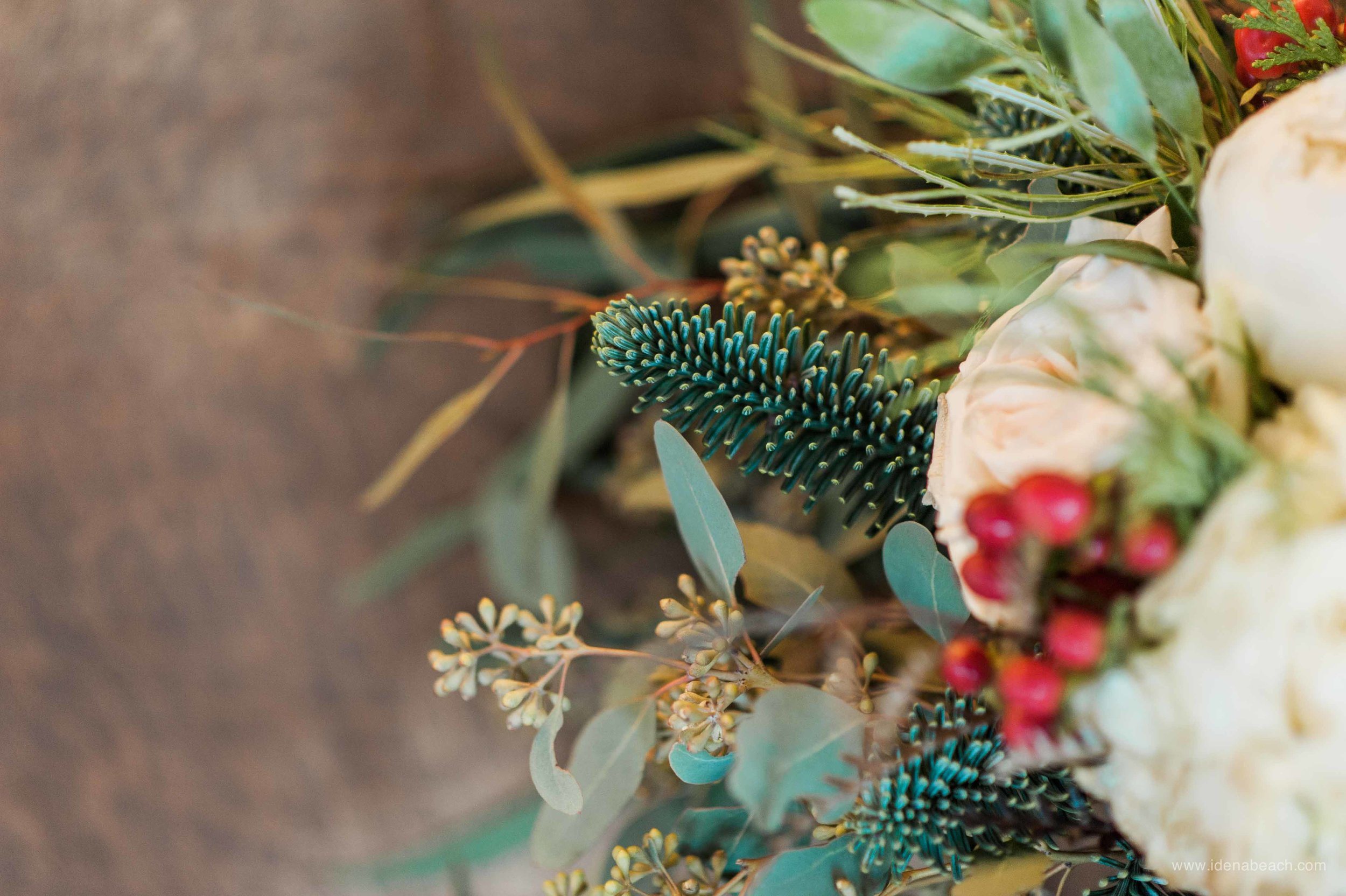 The touch of evergreen made the bouquet smell extra wintery.