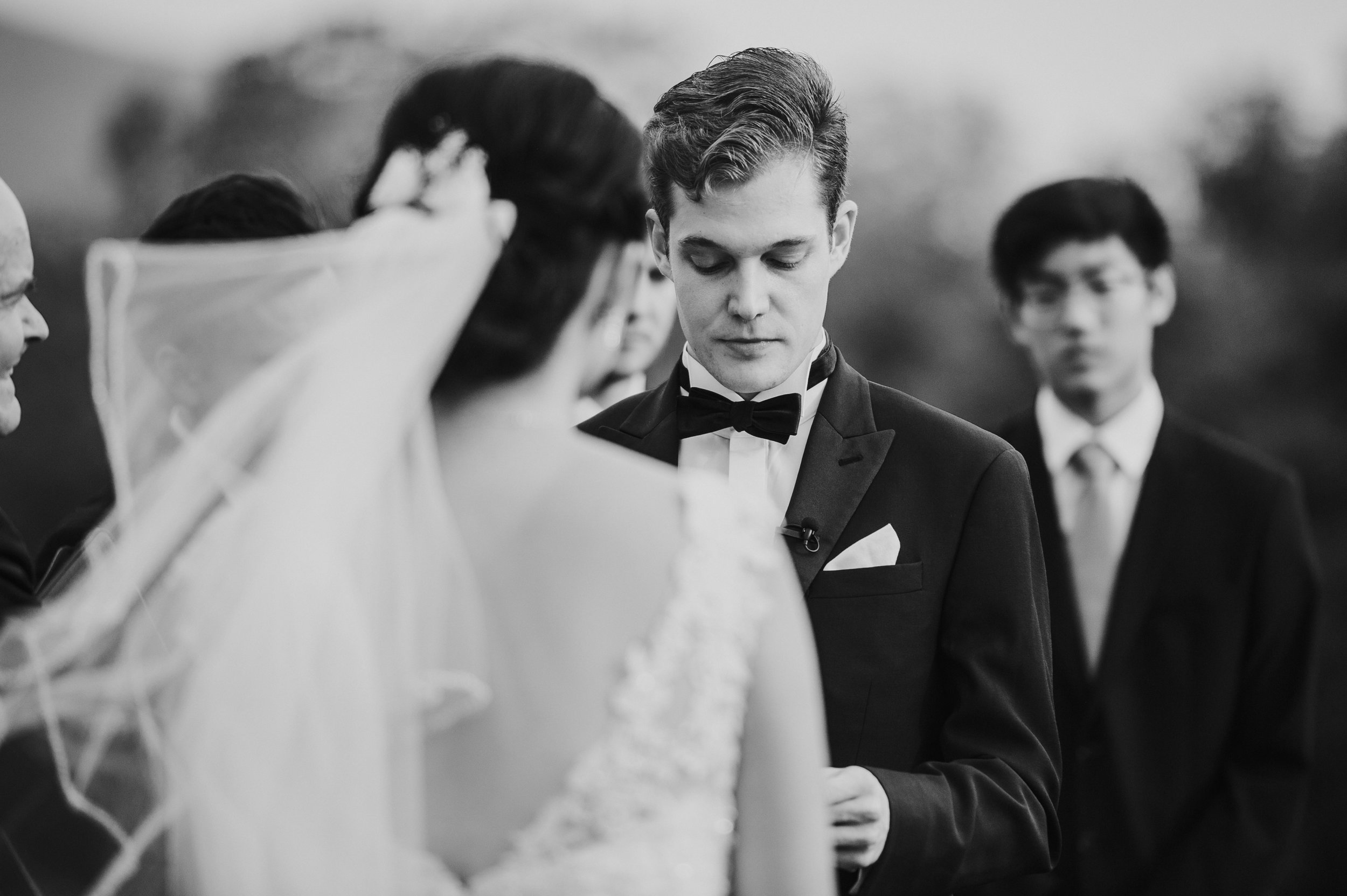 Groom crying while reading his vows