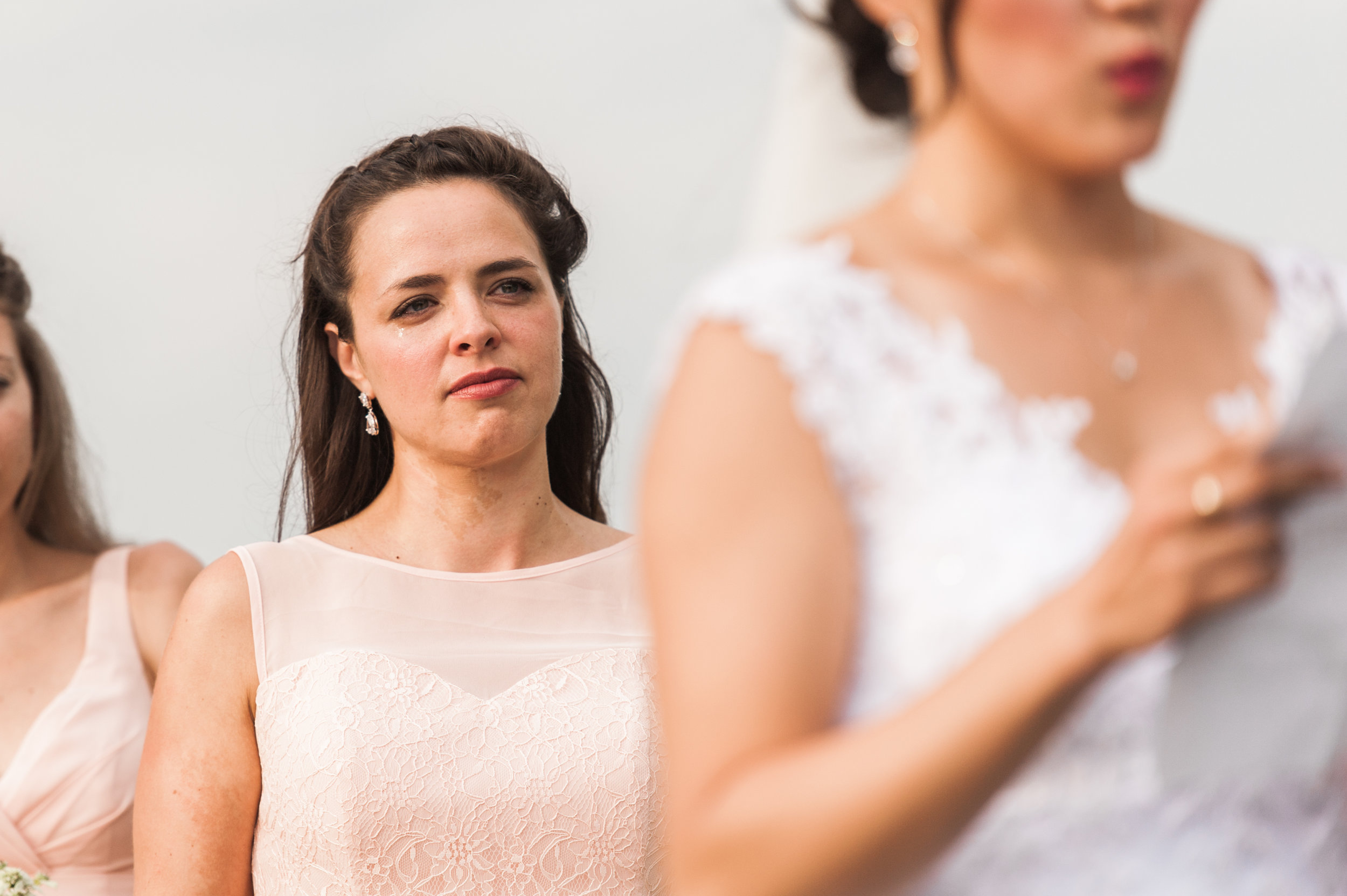 Bridesmaid crying during ceremony