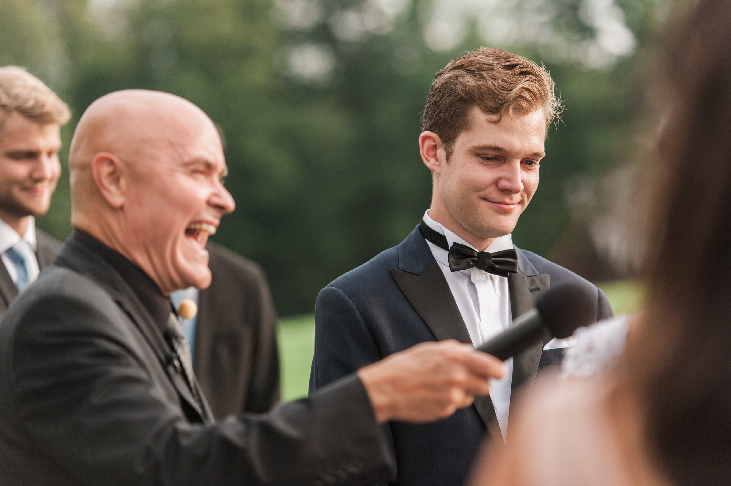 Groom laughing during bride vows at Mountain Top Inn