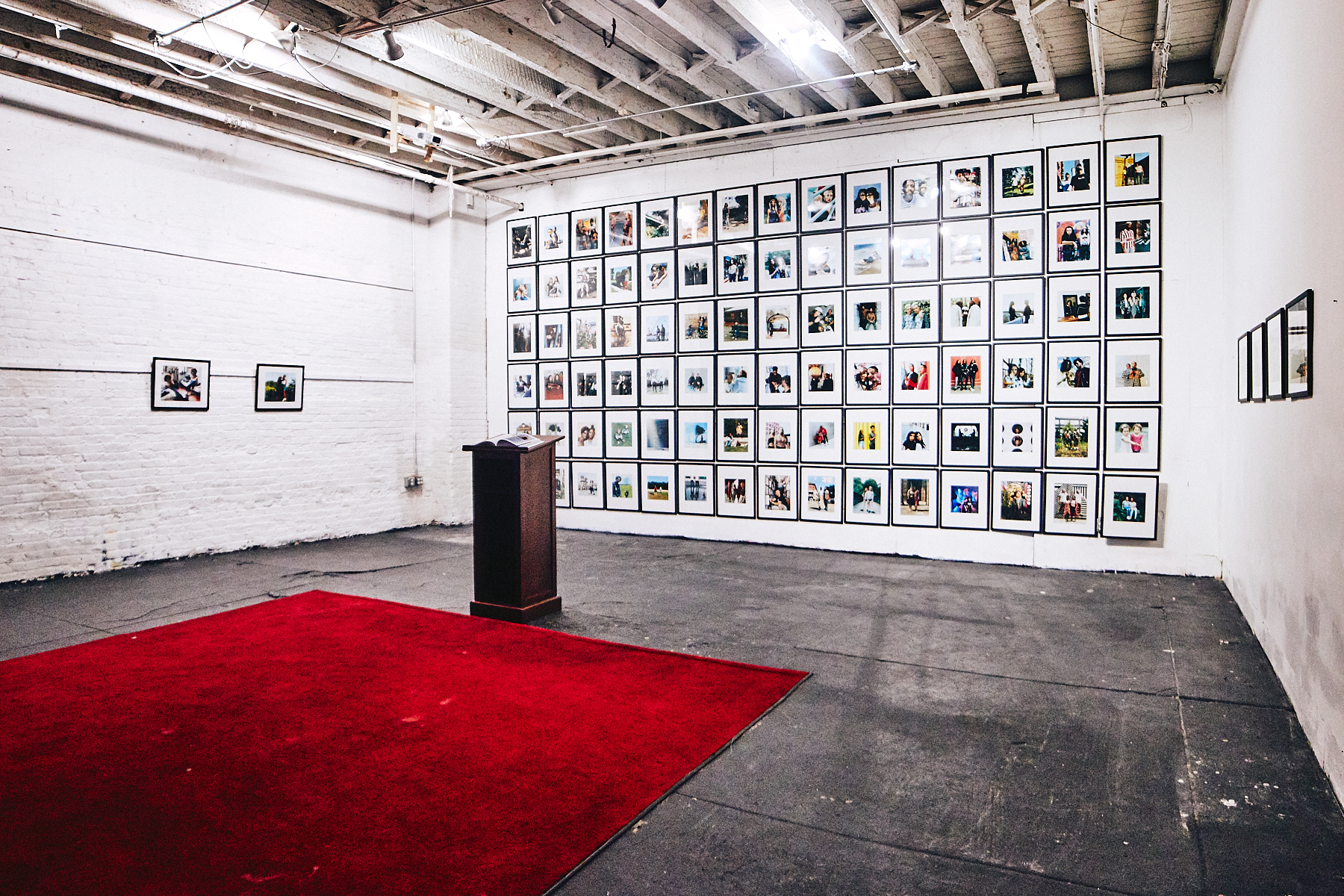 Wide view of C-print Collection and Book Installation on the Back Wall of Superchief Gallery NY.