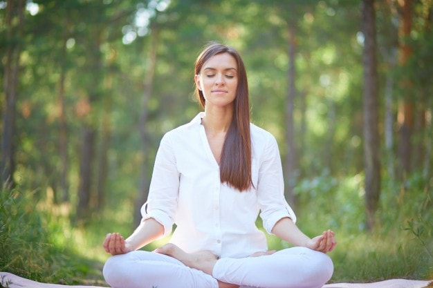 concentrated-woman-meditating-nature_1098-1412-min.jpg