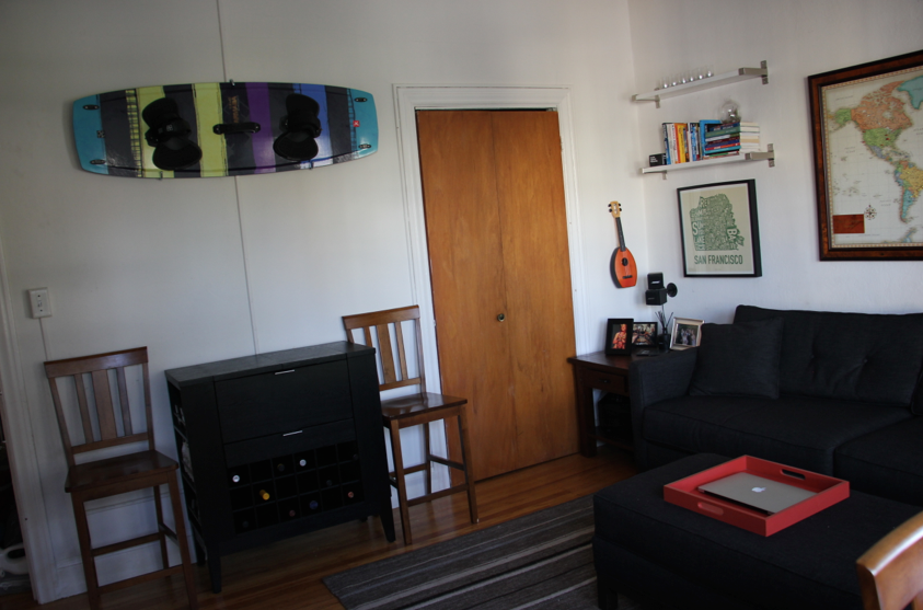 After: Bringing both the kitesurfing board (mounted above the bar) and the bikes (in the closet) out of the bedroom create an entirely new mature and spacious feeling throughout the apartment.