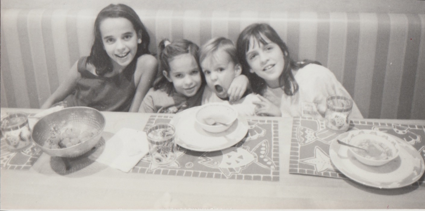 A daily, yet precious memory from childhood.  Around the dinner table with my siblings: Lauren, Robin, Zack and myself.  Yep, I know I had killer bangs.