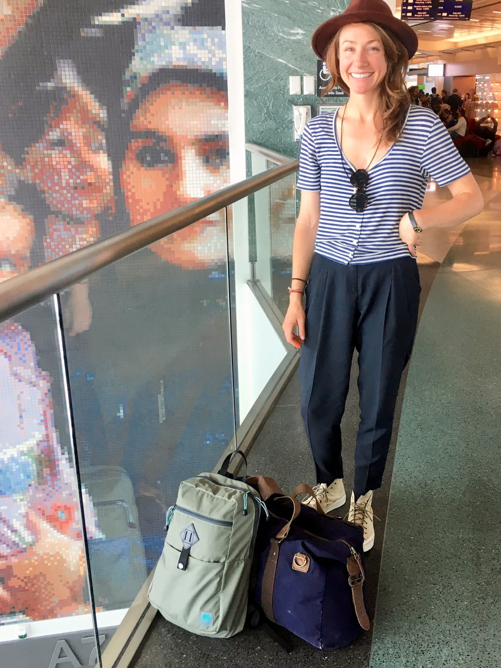 Proud mom moment, making a stranger take a photo of my and my babies, I mean luggage.