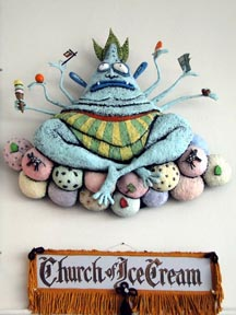 It is the god of ice cream and real estate who watches over shop. This deity was created by Portland Artist, Gesine Kratzner in 2011