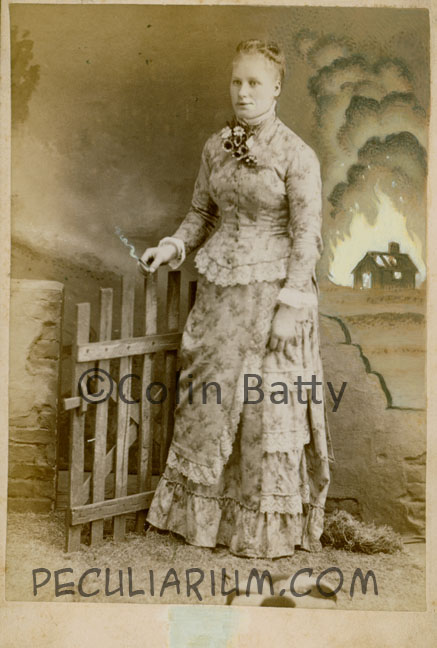 lady with cigarette and burning farm_sm.jpg
