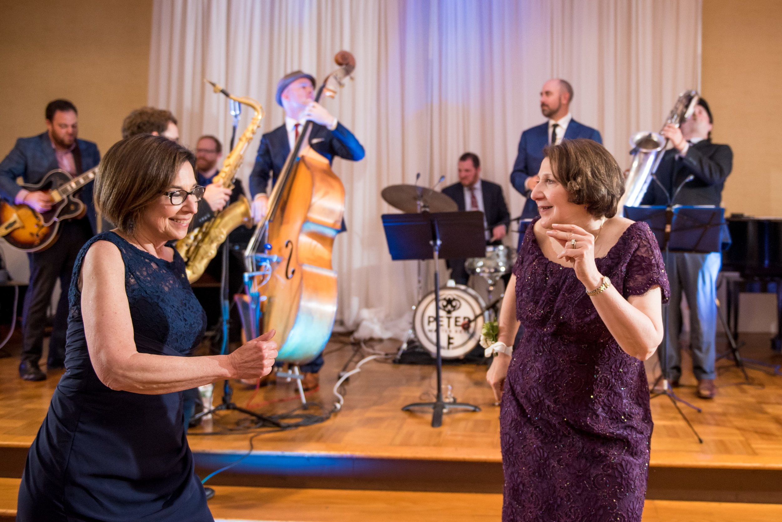 The aunts love it! This jazz wedding band makes sure that folks are dancing.