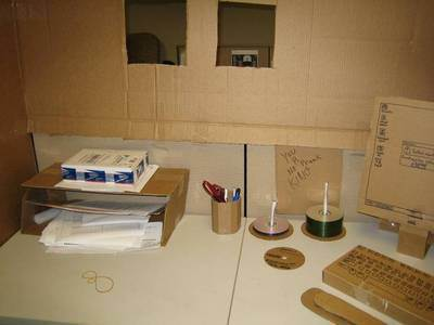 office-practical-joke-carboard-replaces-everything.jpg