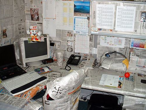 office-covered-and-wrapped-in-newspapper-prank-practical-joke.jpg