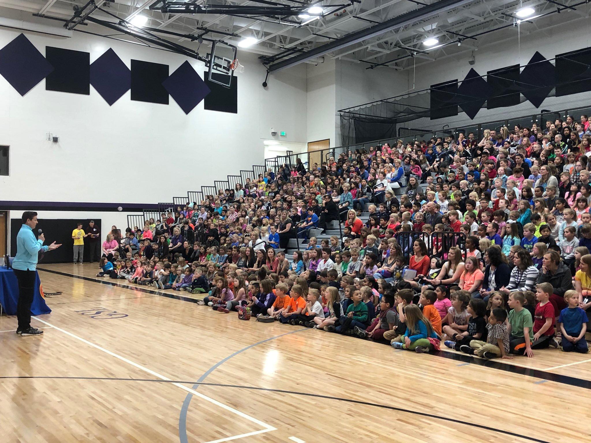 speaking to large school crowd.jpg