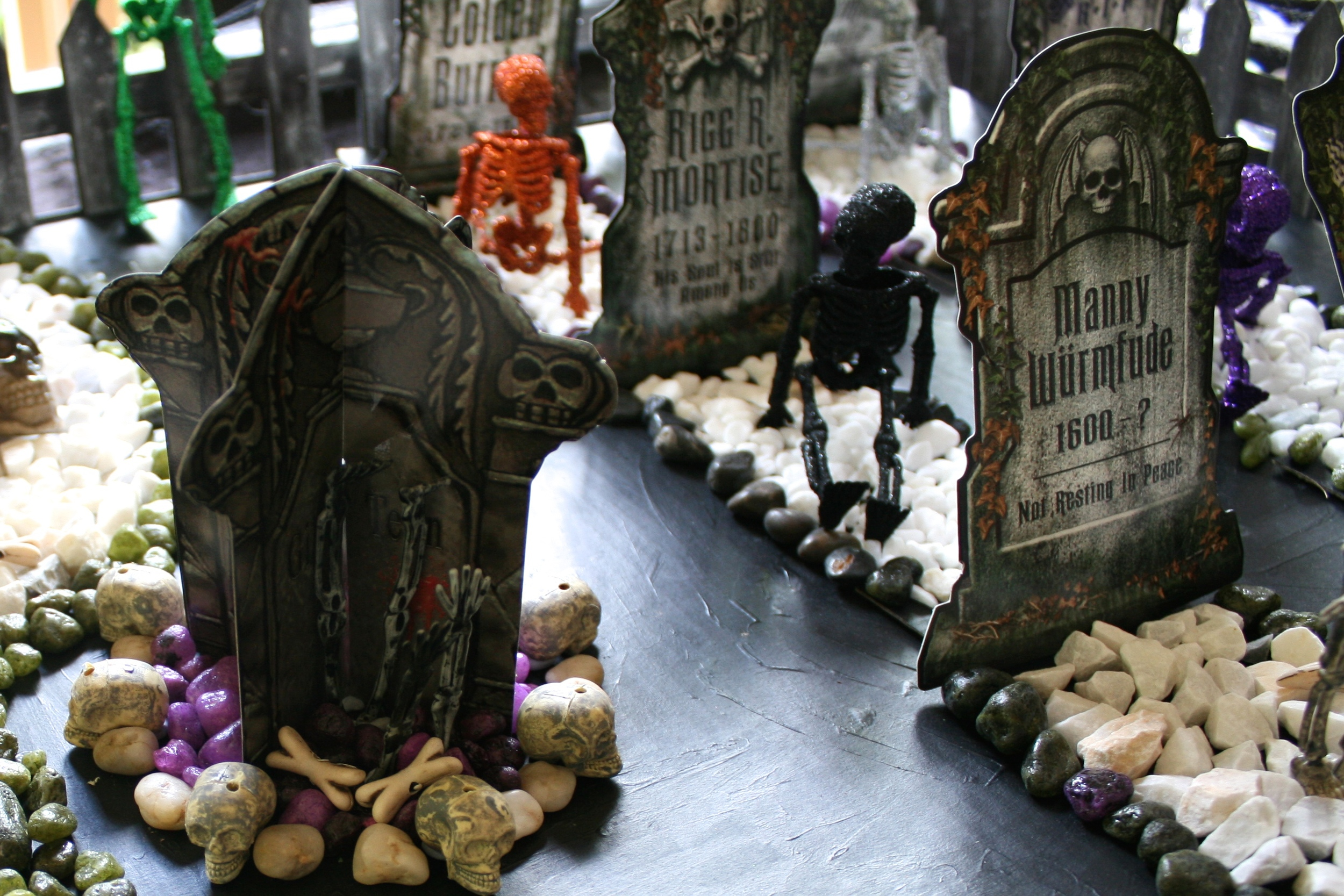 Halloween Graveyard - use dissected skeletons and small jewelry bones to decorate the graveyard