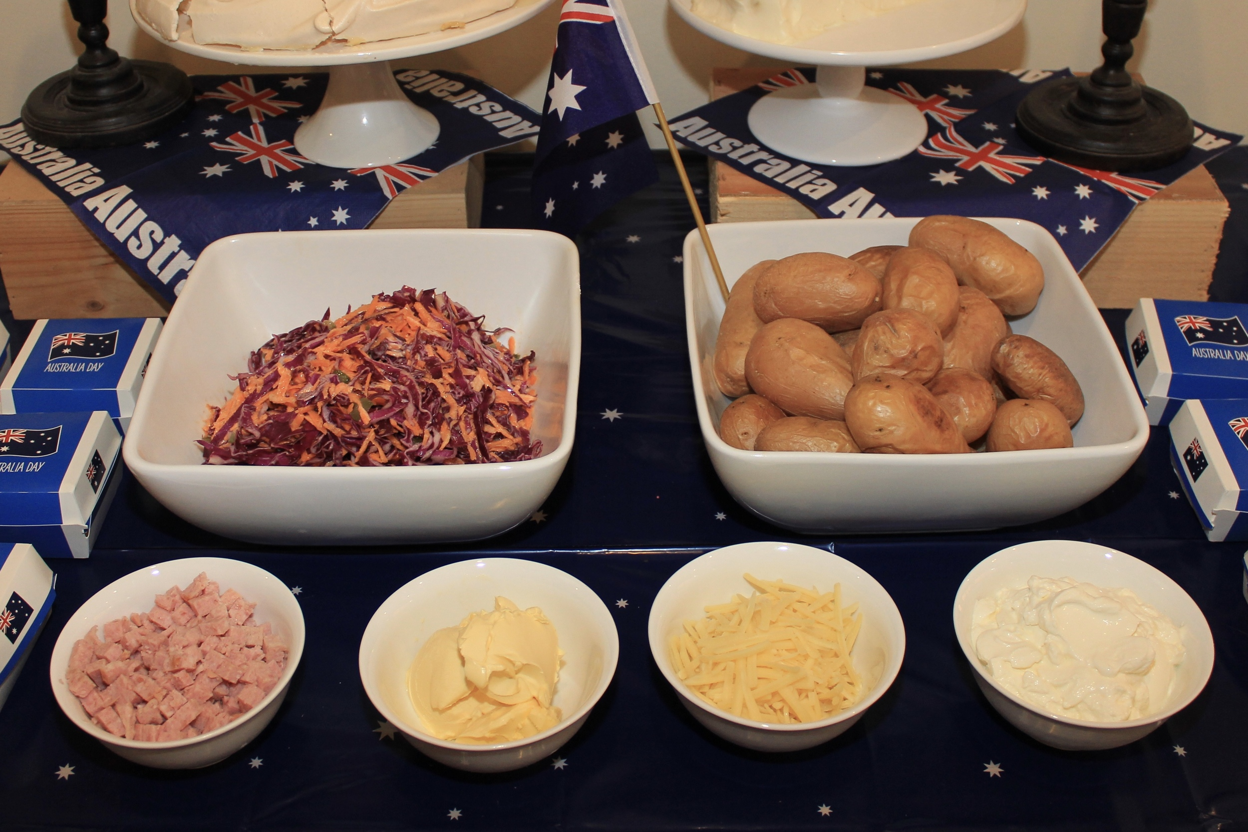 Keep it simple: Potato, coleslaw, bacon, butter, cheese and sour cream.
