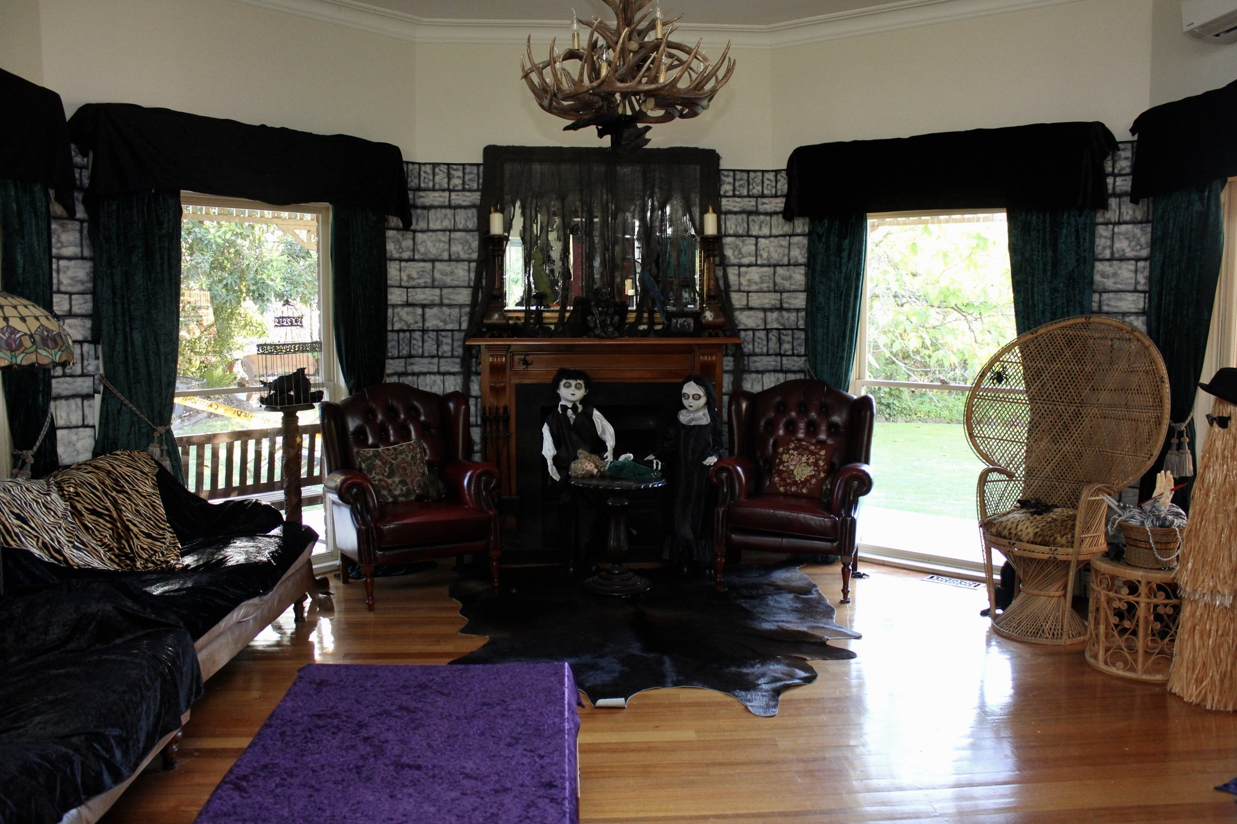 The Addams Family Decorating Ideas, Use vintage furniture and cow hides to transform your room.