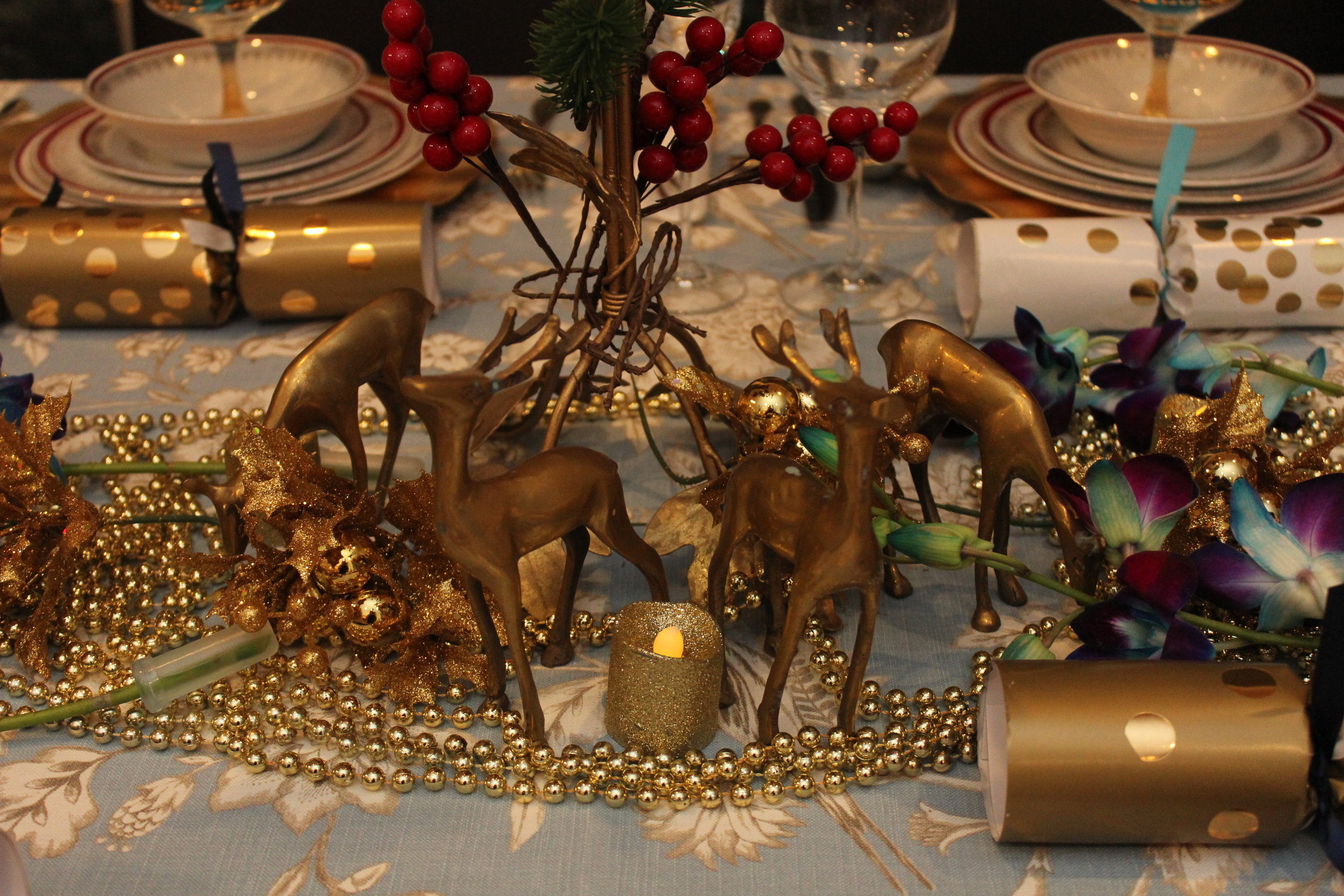 Brass deers grace the table top