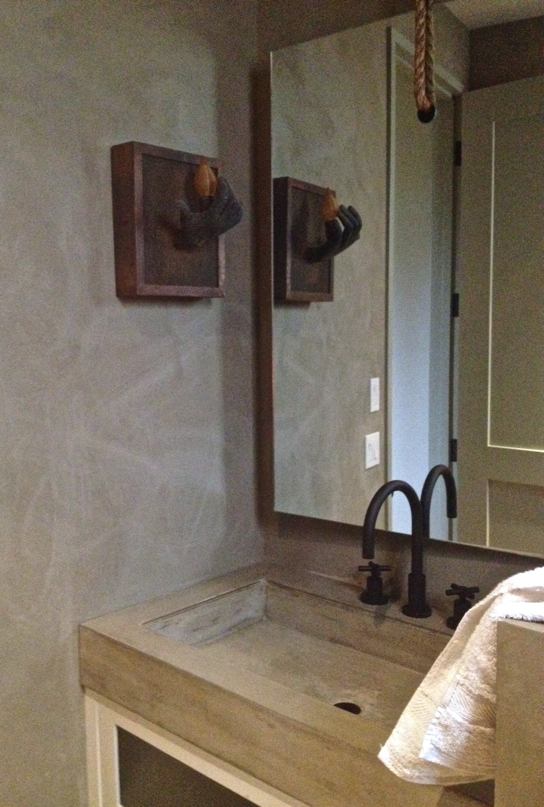 One of our powder bathrooms with American Clay walls