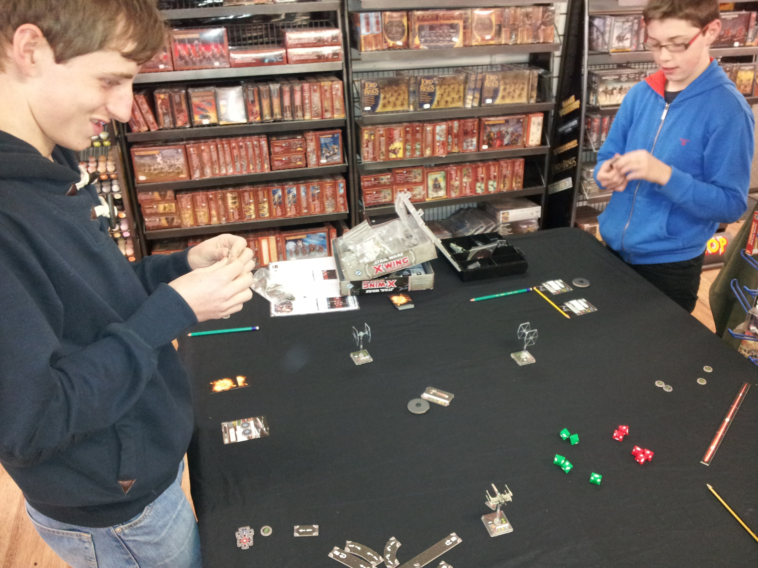 The lads enjoy an X-Wing demo done by our very own Kev
