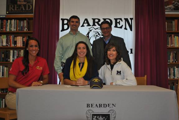 Bearden High School senior Rae Oleshansky is joined by her mother, Deborah Oleshansky and rowing coach, Evelyn Radford, seated, and her father David Oleshansky, and BHS Asst. Principal   Morgan Shinliver ,  standing. Rae announced on Nov. 14   th     her plans to row for the University of Michigan next year.
