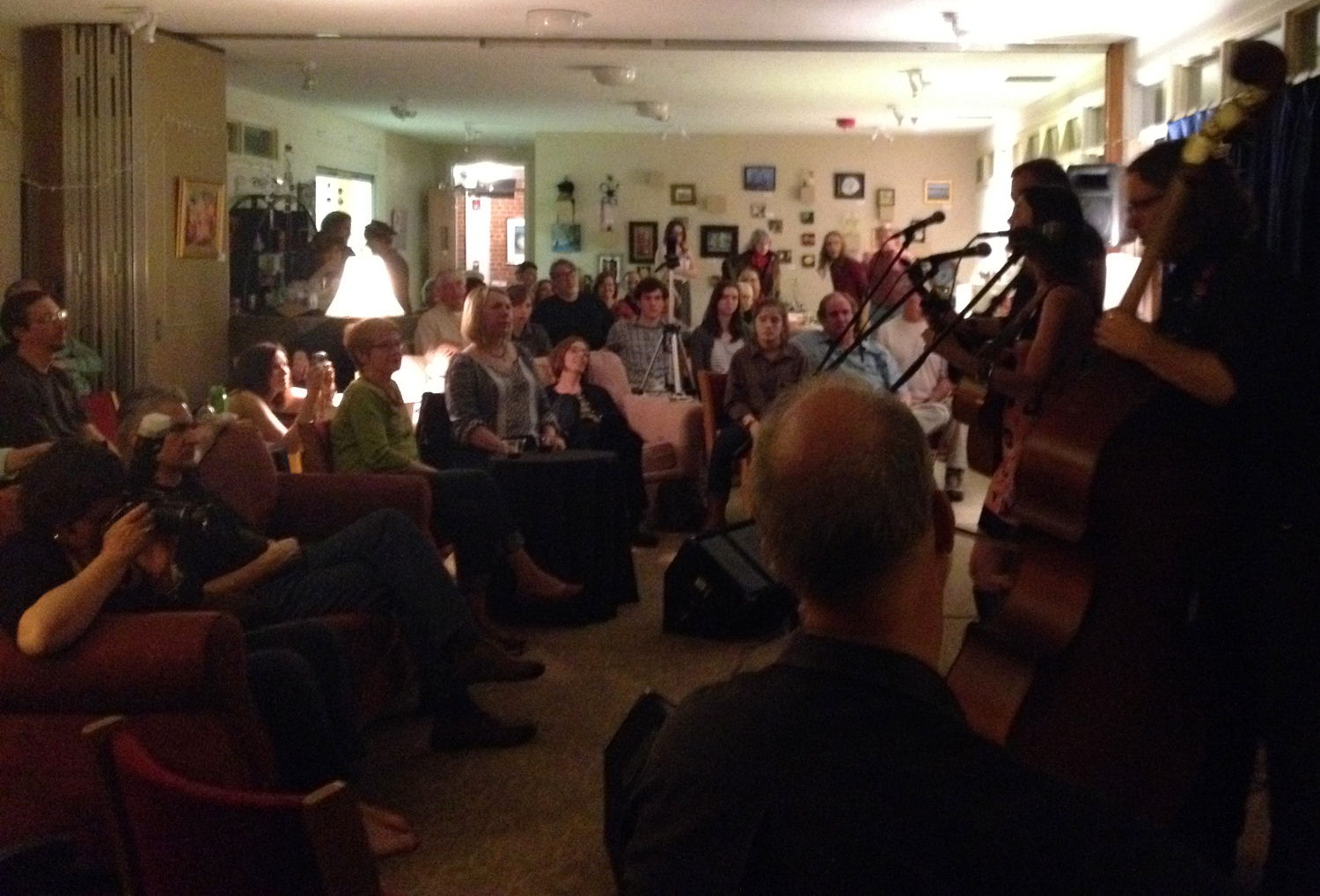 A full house enjoys the sounds of Martha Bassett, Sam Frazier & Pat Lawrence on March 29 at The Creative Center