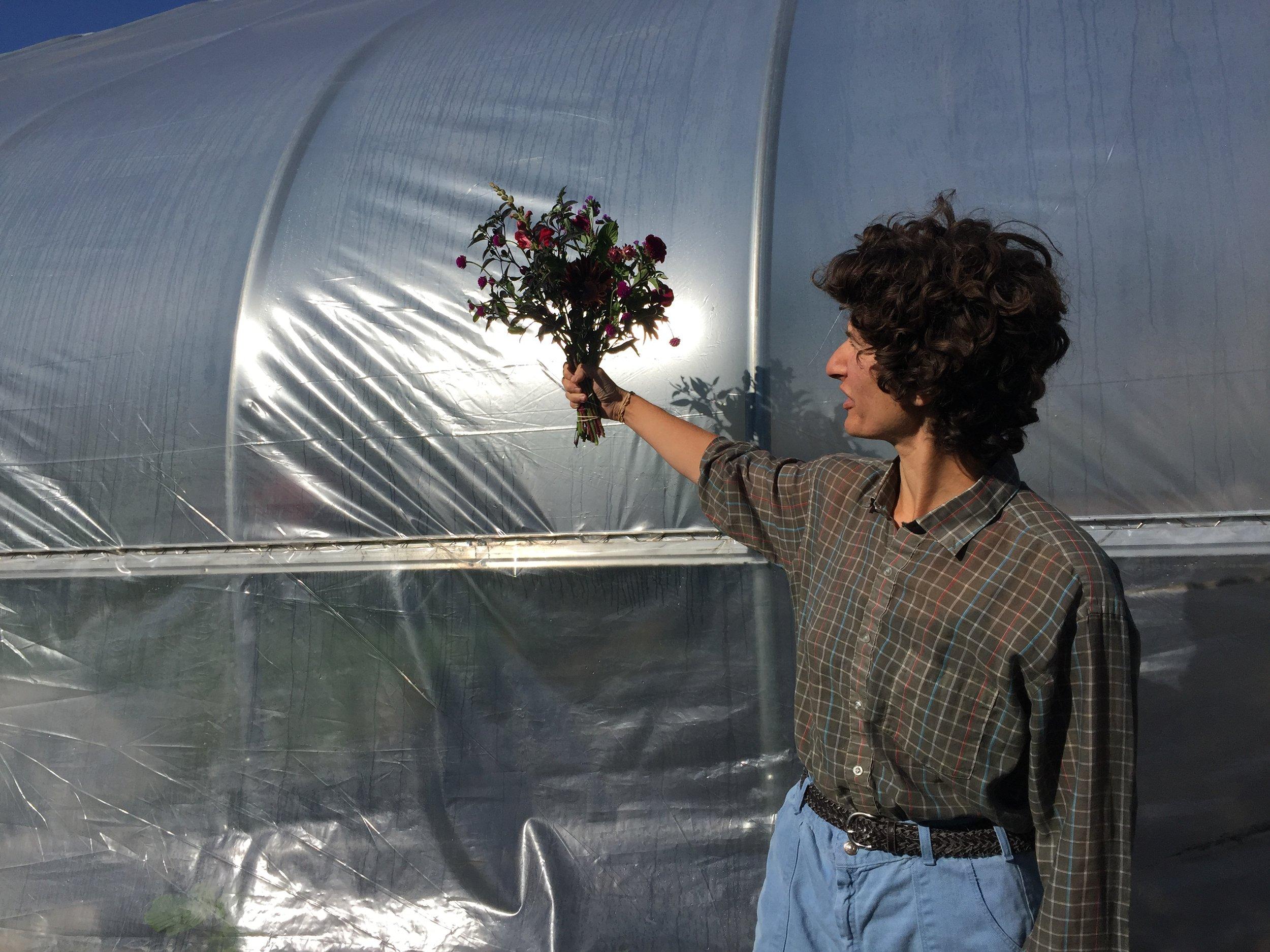 Farmer Sarah holds her work at arm's length.