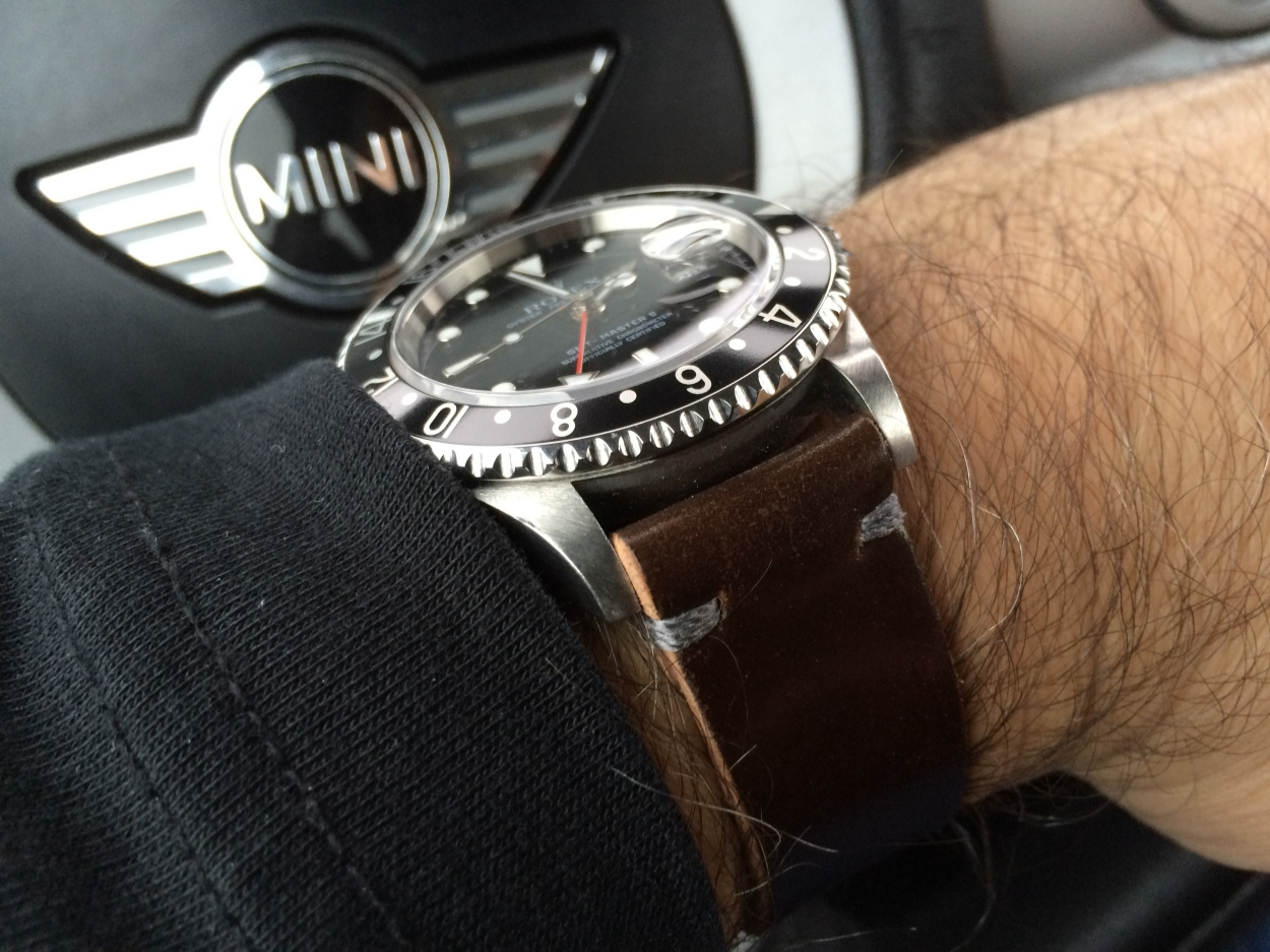 GMT II on a two-piece Cognac strap with gray stitching.