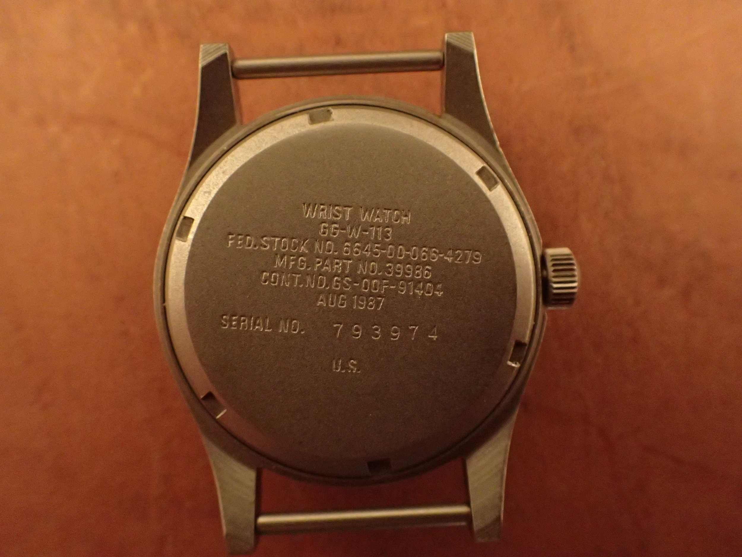 The caseback of the GG-W-113. Note the 00 country code denoting US-issue.